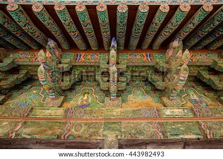 Dancheong(Korean traditional decorative coloring on wooden roof) of Bulguksa temple in Gyeongju, South Korea. - stock photo