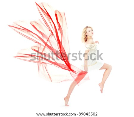 Dancing and moving blond lady on a white background holding red fiber - stock photo