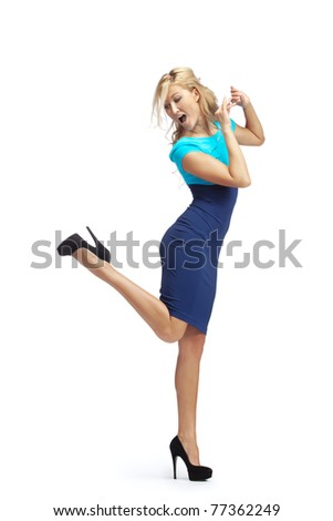 Dancing blonde woman. Isolated over white background - stock photo