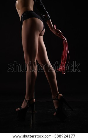 Dancing for adults. Sexy female dancer with whip - stock photo
