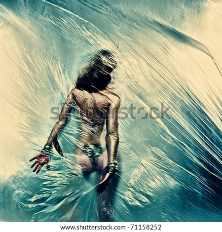 Dancing girl. Polyethylene film disco party. Art photo - stock photo