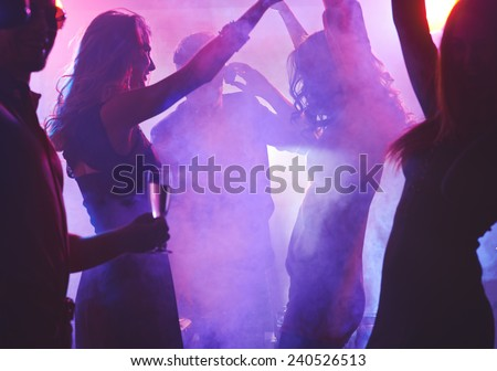 Dancing girls enjoying cool party - stock photo