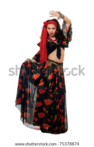 Dancing gypsy woman in a black skirt. Isolated - stock photo