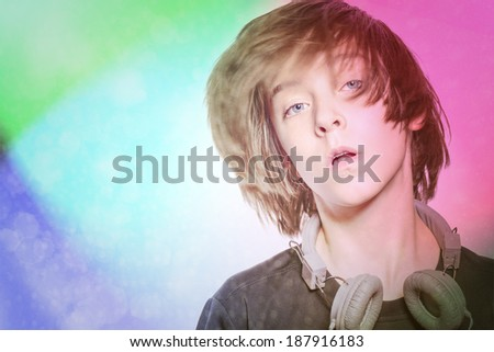 dancing male teenager with headphones and disco background. - stock photo