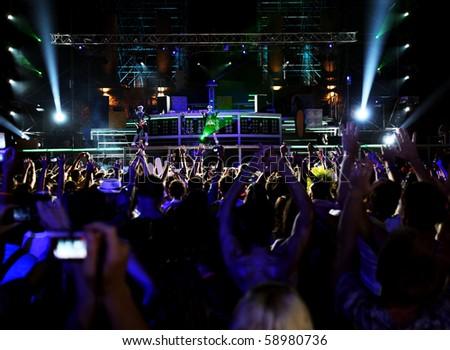 dancing people in outdoor nightclub - stock photo
