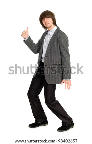 Dancing stylish young man in a gray jacket - stock photo