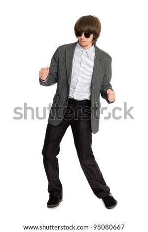 Dancing stylish young man on a white background - stock photo