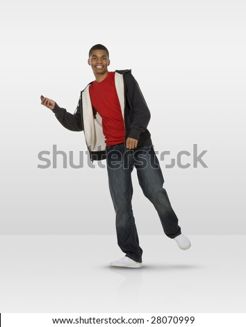 Dancing teen with mobile phone - stock photo