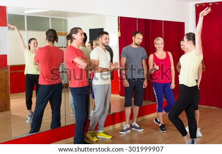 Dancing trainer showing group of people how to dance properly - stock photo