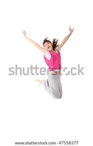 Dancing woman in pink and happy smiling facial expression jumping up. - stock photo