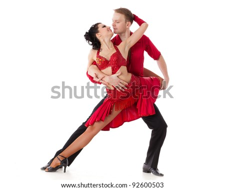 Dancing young couple on a white background. - stock photo