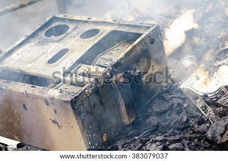 danger, office in a fire , a burning computer - stock photo