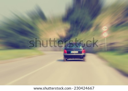 Danger on the road with a 50 speed limit. - stock photo