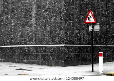 Danger senior crossing sign on an empty road corner - stock photo