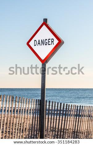 Danger sign at Buckroe Beach in Hampton, Virginia.  - stock photo