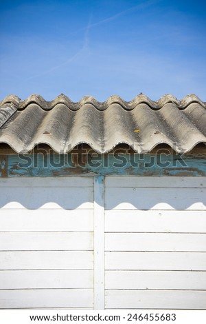 Dangerous asbestos roof with copy space - stock photo