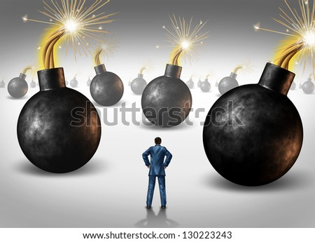 Dangerous challenge as a businessman conquering adversity as he decides on choices he faces as a concept of walking through a minefield as hazardous bombs with burning fuses ready to explode. - stock photo