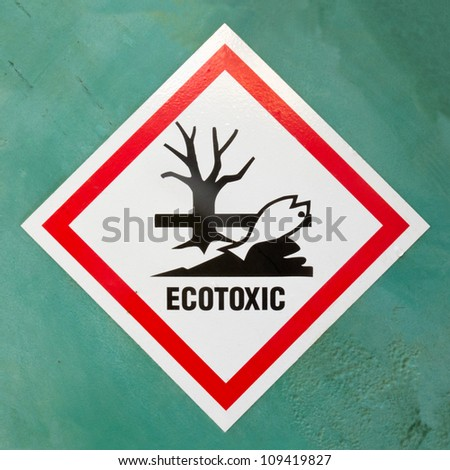 Dangerous for the environment hazard symbol or ecotoxic warning sign on a painted wall warning of lethal consequences to plant and animal life due to toxicity - stock photo