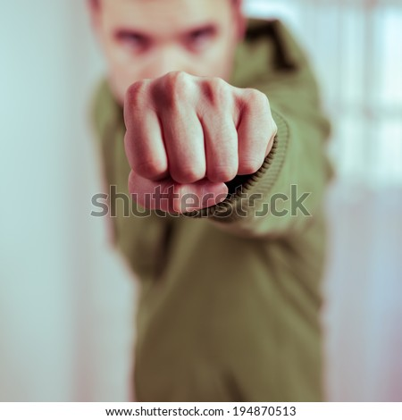 Dangerous man showing fist. - stock photo