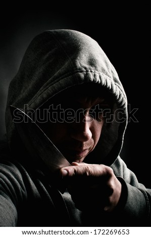 Dangerous man with a knife - stock photo