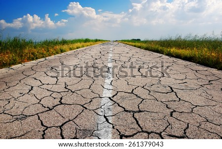 dangerous road with many cracks - stock photo