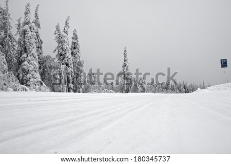 Dangerous snow-covered road in Finland - stock photo