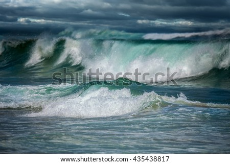 Dangerous stormy weather - dramatic seascape - dark clouds and big ocean waves - stock photo