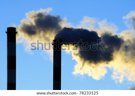 Dangerous toxic clouds from industrial chimneys, pollution concept - stock photo