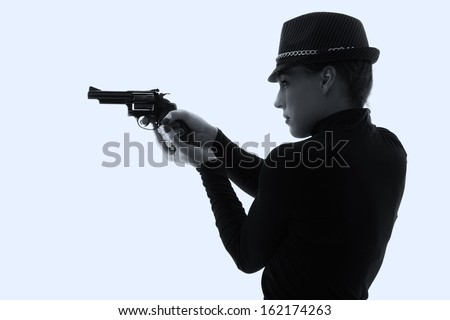 Dangerous woman in black with big handgun and stylish hat artistic conversion - stock photo