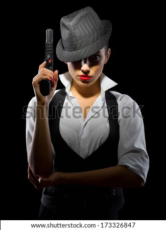 Dangerous young woman with gun isolated - stock photo