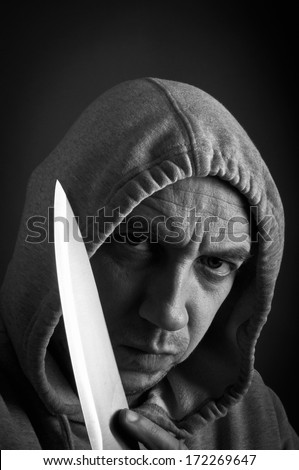 Dangerous youth holding a knife - stock photo