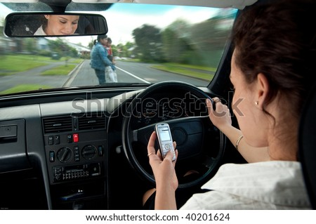 dangers of texting while driving - stock photo