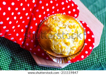 Danish Corn Bread Topping On the tablecloth and Oven glove - stock photo
