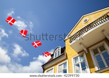 Danish flags and an old villa - stock photo