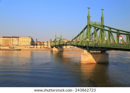 Danube river and long steel bridge painted green, Budapest, Hungary - stock photo