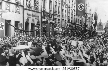 Danzig (Gdansk) greets the Fuhrer on Sept. 19, 1939. German Chancellor, Adolf Hitler receives Nazi Salutes as his rides in victory through Danzig. - stock photo