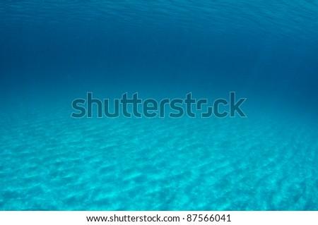 Dappled sandy bottom just off shore of a South Florida Beach. - stock photo