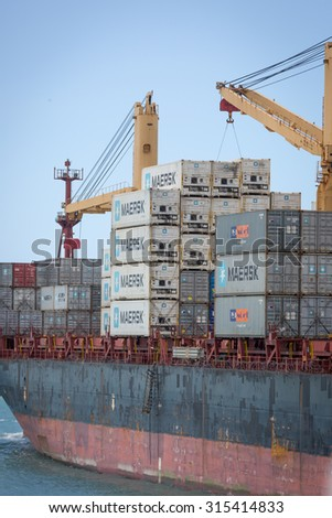 DAR ES SALAAM AREA, TANZANIA - AUGUST 9, 2015: Big vessel carrying hundreds of containers in the Dar es Salaam area, Tanzania, Africa - stock photo