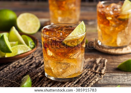 Dark and Stormy Rum Cocktail with Lime and Ginger Beer - stock photo