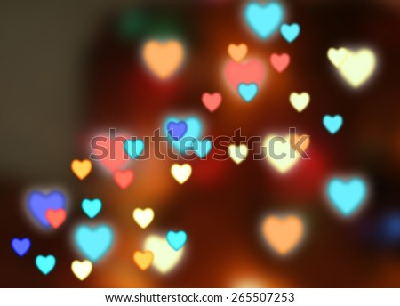 Dark background with color hearts - stock photo