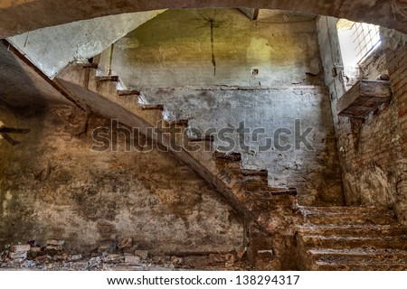 dark basement with stairs and window of an old abandoned country house - stock photo
