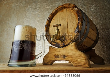 Dark beer on the table. - stock photo