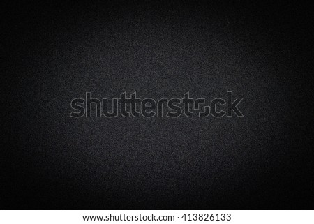 Dark black background texture with shiny speckles of random colour noise vignetted - stock photo
