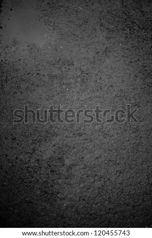 Dark black wet slippery asphalt to be used as texture or background - stock photo