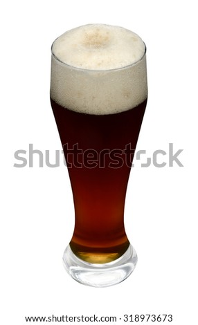 Dark black wheat beer poured in glass with head - stock photo