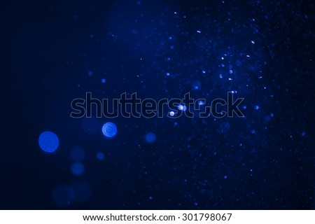 Dark blue abstract backgrounds with bokeh  - stock photo