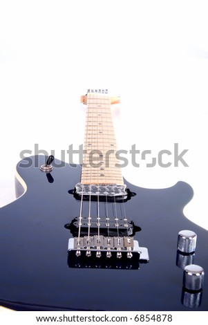 Dark blue and chrome electric guitar from extreme perspective faded into pure white - stock photo