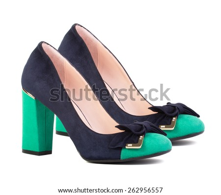 Dark blue female shoes with green heels isolated on white background - stock photo