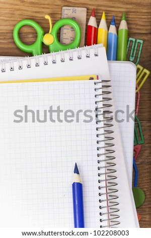 dark blue pencil on a blank sheet of a writing-book - stock photo