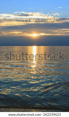 Dark blue sea sunset - stock photo